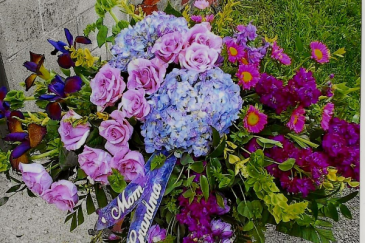 Love shades of purples casket spray