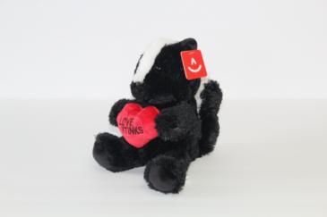 """Love Stinks"" Skunk Stuffed Animal"