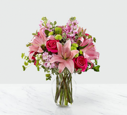 Lovely lilies  Fresh arrangement in a vase