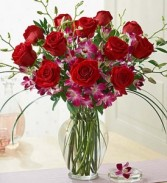 Sophicated Splendor Ruby Roses and Vibrant Dendrobium Orchids