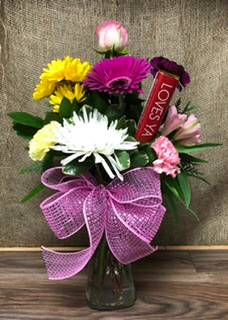 Loves ya Flower arrangement with chocolate bar