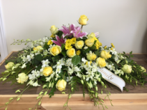 Cherished memories Casket arrangement