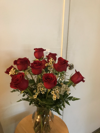 Lovingly yours Red roses bouquet with wax floer