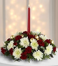Christmas Favorite!! Centerpiece with red and white flowers and Christmas greens with trim and candle