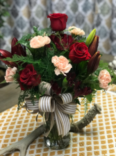 Luscious blooms Mixed roses with carnation and alstroemerias in red and peach