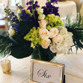 Lush centerpieces for any special occasion White roses, purple stock, and white hydrangeas
