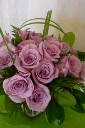18 Lush Purple Roses Roses in a clear vase