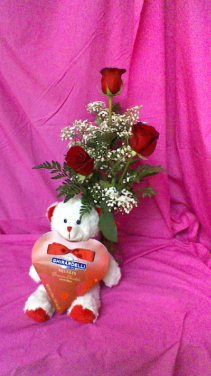 RV3V Luv Ya !!!! Bud vase of 3 red roses and baby breath along with stuffed teddy bear holding valentines day chocolates