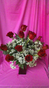 R12RD Mad About Red Dozen Long Stem Roses in a red vase