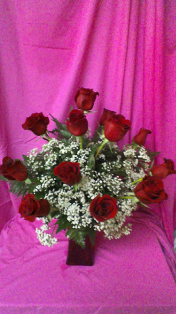 Mad About Red Dozen Long Stem Roses in a red vase