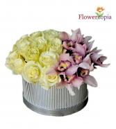 Madly In Love White Roses & Orchid blooms arrangement