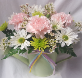 """Make em Smile""Cute watering tin filled with  carnations, daisies and green poms with wax flower.(water can tin may vary in color or design)"