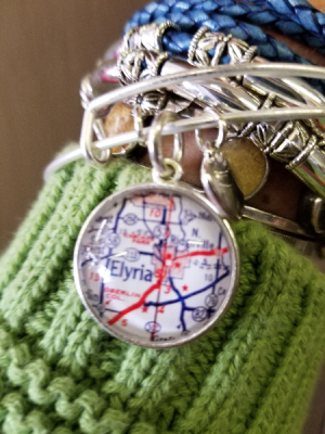 Map Bracelet   in Elyria, OH | PUFFER'S FLORAL SHOPPE, INC.