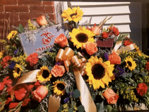 Marines  Fresh with sunflowers, orange roses,  red glass and more