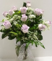 Lavender Medium Roses Arranged in glass vase