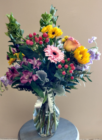 Medium mixed flower vase arrangement with a mixed variety of garden flowers.
