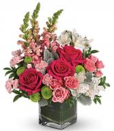 Medley of pink blooms  Vase