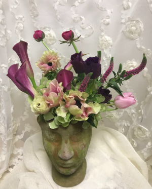 Medusa Floral arrangement in sculptured pottery  in Northport, NY | Hengstenberg's Florist