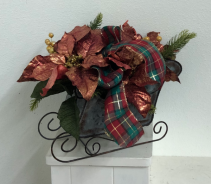 Metal sleigh with silk poinsettias and greenery Silk