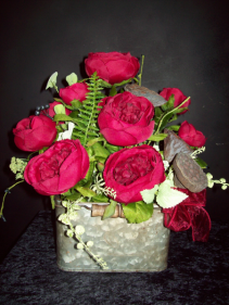 Metal tin flower arrangement Silk open red roses in tin container.