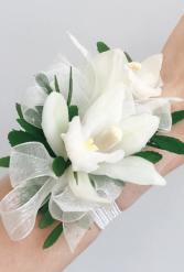 Mini white cymbidium orchid wristlet  Corsages