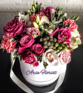 Mix colors of seasonal flowers into a box Bouquet **FREE BOX OF CHOCOLATE**