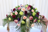 MIXED COLORED CARNATIONS CASKET SPRAY