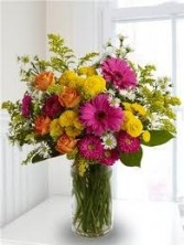 GW 11-Mixed flower arrangement in a tall vase (Flowers and colors may vary)