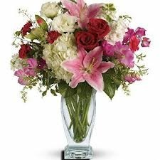 225 & OC 3-Mixed flower arrangement in a tall vase Flowers and colors may ...