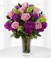 B 14-Mixed flower arrangement in a vase (flowers and colors may vary)