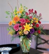 B 11-Mixed flower arrangement in a vase (Flowers and colors may vary)