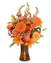 Th 2-Mixed Flower arrangement in a vase Flowers and colors may vary