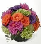 BS 5-mixed flowers in a compact arrangement (Flowers and colors may vary)