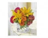 JB 10-Mixed flowers in a compact arrangement (flowers and colors may vary)