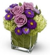 NB 3-Mixed flowers in a compact vase arrangement (Flowers and colors may vary)