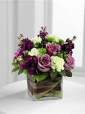 B 12-Mixed flowers in a compact vase arrangement (Flowers and colors may vary)