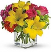 B 2-Mixed flowers in a compact vase arrangement (Flowers and colors may vary)