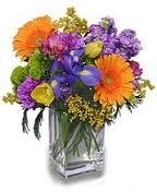 SE 1-Mixed flowers in a compact vase arrangement Flowers and colors may vary