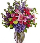 B 1-Mixed Flowers in a tall vase  (Flowers and Colors may vary)