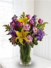 B 4-Mixed flowers in a tall vase  (Flowers and colors may vary)