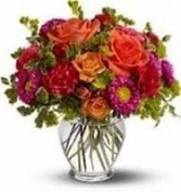 B 8-Mixed Flowers in a vase  (Flowers and colors may vary)