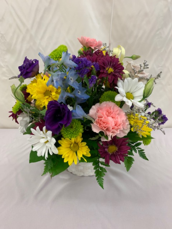 Mixed Flowers in basket Just because