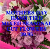 Mixed seasonal cut flowers  Hand tied NO vase