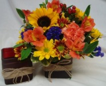 Cute colored cubes with seasonal flowers arranged!