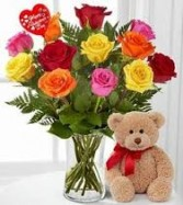 DOZEN MIXED ROSES ARRANGED IN A VASE WITH A MEDIUM BEAR AND HEART PIC all for 85.95