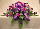 LAVENDER TRIBUTE  Half Casket Spray of of dark and light purple carnations and ribbon and baby's breath