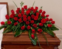 LOVE FOREVER  Half Casket Spray of  red roses and greens