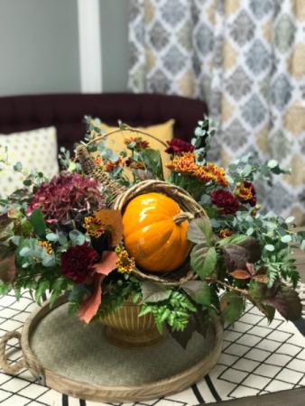 Modern fall floral  Gorgeous lush greens with cornucopia and pumpkin