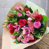 Heavenly florist signature bouquet Beautiful assorted flowers artfully wrapped