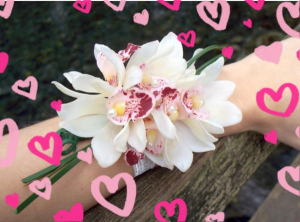 Double Orchid Wrist Corsage  Adored with ribbon and glitz.  in Ozone Park, NY   Heavenly Florist